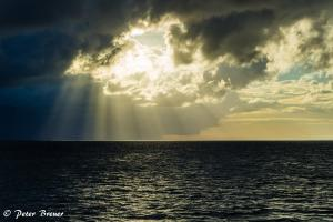 Sunburst Through Storm Clouds
